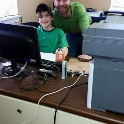 Father and son at computer